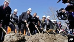 FILE - Taunton Mayor Thomas Hoye, far left, Tribal Chairman Cedric Cromwell, third from left, and others wield shovels during an official casino groundbreaking, April 5, 2016, in Taunton, Mass. (AP Photo/Elise Amendola)