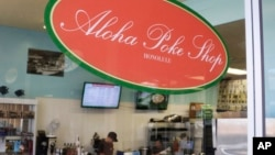 This Tuesday, April 16, 2019, photo the Aloha Poke Shop in Honolulu, Hawaii. (AP Photo/Audrey McAvoy)