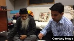 طارق اعوان عبدالستار ایدھی کے ساتھ کھانا کھاتے ہوئے