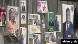 Campaign signs of presidential candidates can be seen in Ouagadougou, Burkina Faso, for the upcoming election.