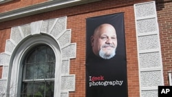 "The Rutland Free Library features a large poster of popular local hotdog vendor Lenny Montuori as part of the ""Geek the Library"" campaign in Rutland, Vermont."