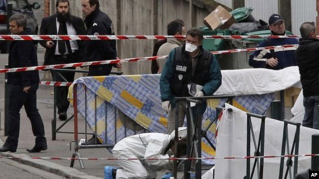 Police gather at the site of a shooting in Toulouse, southwestern France, Monday, March 19, 2012.