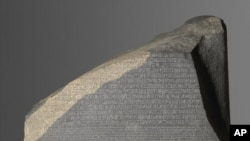 The Rosetta Stone from el-Rashid, Egypt. This artifact, which was created in 196 B.C., unlocked Egyptian hieroglyphics.