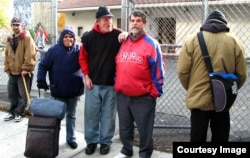 Homeless people outside St. Francis Inn, in the Kensington section of Philadlephia.