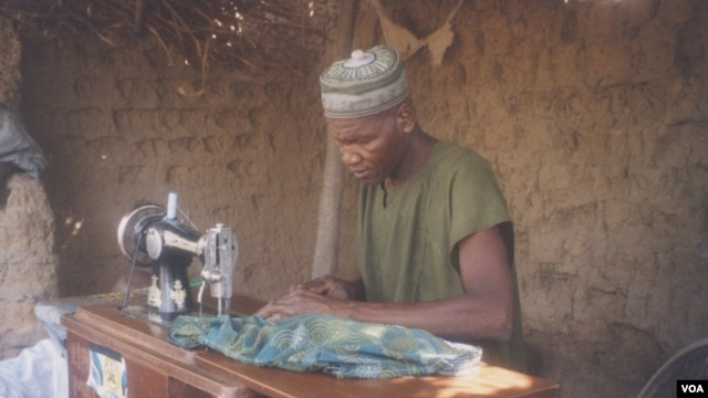Electricity has enabled people in some areas of northern Nigeria to open businesses, such as this man's tailoring enterprise (SELF)