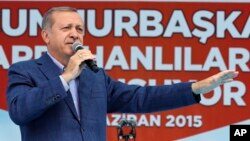 FILE - President Recep Tayyip Erdogan addresses a rally ahead of general elections in Ardahan, Turkey, June 6, 2015.