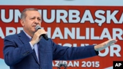 FILE - Turkey's President Recep Tayyip Erdogan addresses an election rally ahead of the upcoming general elections, in Ardahan, Turkey, June 6, 2015.