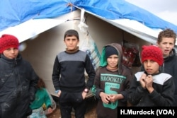 Children, pictured in al-Hol Camp, Syria, March 4, 2019, say they felt safer living in a war zone than they do in the camp, because they were told that IS militants were protecting them.