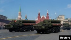 FILE - Russian servicemen drive S-400 missile air defense systems during the Victory Day parade, marking the 73rd anniversary of the victory over Nazi Germany in World War II, at Red Square in Moscow, Russia, May 9, 2018.