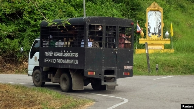 Thai immigration police van carries a group of Rohingya Muslims to a port outside Ranong, Oct. 30, 2013.