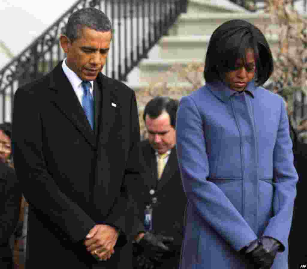 January 10: President Barack Obama, first lady Michelle Obama, and government employees observe a moment of silence on South Lawn of the White House in Washington, to honor those who were killed and injured in the shooting in Tucson, Ariz. Rep. Gabrielle