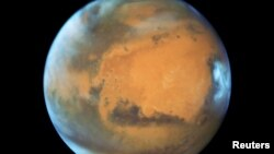 FILE - The planet Mars is shown May 12, 2016 in this NASA Hubble Space Telescope view when it was 50 million miles from Earth.