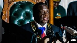 FILE: Zimbabwean President Emmerson Mnangagwa delivers his state of the nation address at a joint sitting of the parliament and the senate in Harare on December 20, 2017.
