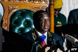 FILE - Zimbabwean President Emmerson Mnangagwa delivers his state of the nation address at a joint sitting of the parliament and the senate in Harare on December 20, 2017.