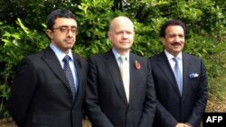 British Foreign Secretary William Hague (C), Emirati Foreign Minister Sheikh Abdullah bin Zayed al-Nahayan (L) and Pakistani Interior Minister Rehman Malik (R) posing for a picture during their visit to the Queen Elizabeth Hospital, where shot Pakistani schoolgirl Malala Yousafzai is receiving treatemnt, October 29, 2012.