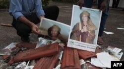 Dân chúng Libya đốt hình ảnh để ăn mừng sự kết thúc chế độ Gadhafi