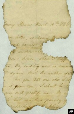 This undated photo provided by The Papers of Abraham Lincoln, a project administered by the Abraham Lincoln Presidential Library and Museum in Springfield, Illinois, shows a letter fragment found inside a wall at Abraham Lincoln's Springfield home.