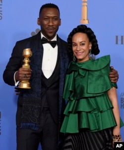 "Mahershala Ali, left, winner of the award for best performance by an actor in a supporting role in any motion picture for ""Green Book,"" and Amatus Sami-Karim pose in the press room at the 76th annual Golden Globe Awards"