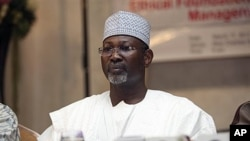 Nigeria's electoral chief and academic Attahiru Jega attends a meeting with staff from the Independent National Electoral Commission in Abuja, March 17, 2011