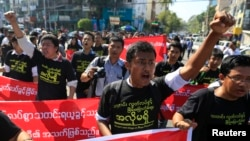 FILE - Reporters shout as they march demanding broader press freedom in Yangon, Myanmar, Jan. 7, 2014. A similar protest is planned for Thursday when two prominent journalists are to go on trial for alleged defamation.