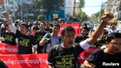 FILE - Reporters shout as they march demanding broader press freedom in Yangon, Myanmar, Jan. 7, 2014.