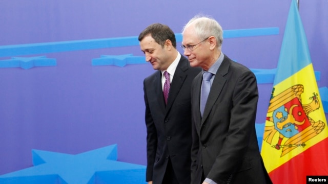 FILE - European Council President Herman Van Rompuy (R) is seen with Moldova's Prime Minister Vlad Filat in Brussels December 12, 2011.