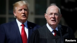 FILE - U.S. President Donald Trump listens as Justice Anthony Kennedy speaks before swearing in Judge Neil Gorsuch as an Associate Supreme Court Justice at the White House in Washington, April 10, 2017.