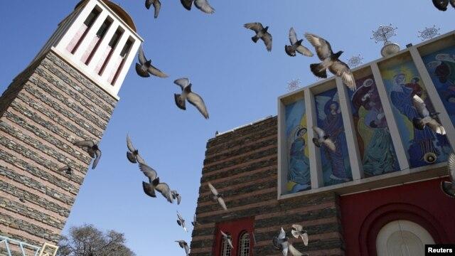 Pigeons fly outside the Nda Mariam Orthodox Cathedral in Eritrea's capital Asmara, Feb. 16, 2016.