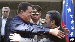 Iranian President Mahmoud Ahmadinejad, right, welcomes his Venezuelan counterpart Hugo Chavez, during official ceremony, in Tehran, Iran, 19 Oct. 2010.