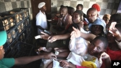 Rushing to buy bread as wheat runs short and food prices rise in Mozambique.