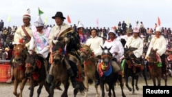 Tibetan men race their horses