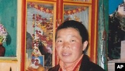 Tibetan nun Palden Chetso who died after setting herself on fire in southwestern China is seen in this undated file photo.