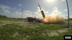 A Terminal High Altitude Area Defense (THAAD) missile is launched from a THAAD battery. Plans to deploy the missile system have been criticized by North Korea, China and Russia.