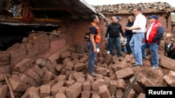 Peru's President Ollanta Humala (2nd R) visits a damaged area after a 5.1 magnitude earthquake hit Paruro, Cuzco, Sept. 28, 2014, in this Presidential handout photo.
