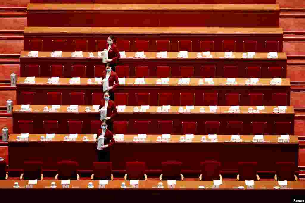 Attendants wearing face masks are seen before the second plenary session of the National People's Congress at the Great Hall of the People in Beijing, China.