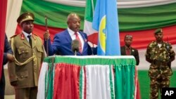 FILE - Burundi's President Pierre Nkurunziza is seen being sworn in for a third term at a ceremony in the parliament in Bujumbura, Burundi, Aug. 20, 2015.