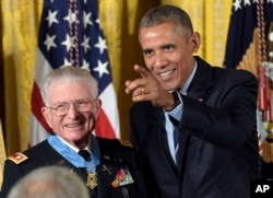 President Barack Obama points after presenting the Medal of Honor to retired Lt. Col. Charles Kettles of Michigan during a ceremony in the East Room of the White House in Washington, July 18, 2016.