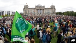 Activist gather for a Fridays for Future global climate strike in front of the parliament building in Berlin, Germany, Sept. 24, 2021.