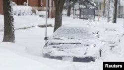Badai musim dingin menimpa Iowa (20/12), memicu angin kencang dan hujan salju yang tebal. (AP)