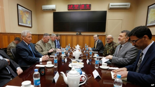 U.S. Secretary of Defense Chuck Hagel, left, meets with Afghanistan's Defense Minister Bismallah Khan Mohammadi, second right, at the ISAF (International Security Assistance Force) headquarters in Kabul, March 10, 2013.