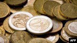 FILE - An image displays euro coins.