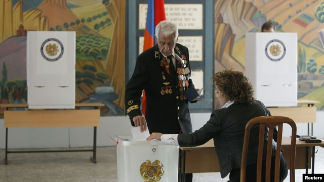 A man casts his ballot during the presidential election at a polling station in Yerevan, February 18, 2013.