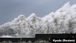 High waves triggered by Typhoon Jebi are seen at a fishing port in Aki, Kochi Prefecture, western Japan,in this photo taken by Kyodo, Sept. 4, 2018.