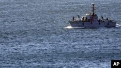 An Israeli military naval ship patrols inside the port of Ashdod, in the Mediterranean Sea, Israel, March 15, 2011.