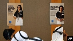 Kuwaiti journalists attend a Human Rights Watch press conference in Kuwait City announcing a new report that shows abuse of domestic workers in Kuwait is rising, and maids in the Gulf emirate face prosecution when they try to escape, 6 Oct 2010 (file phot