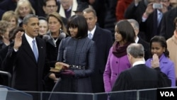 President Barack Obama receives the oath of office from Chief Justice John Roberts at the ceremonial swearing-in at the U.S. Capitol during the 57th Presidential Inauguration in Washington, Monday, Jan. 21, 2013.