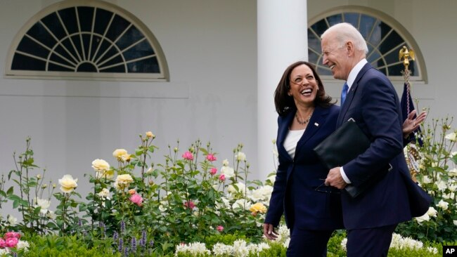 President Joe Biden and Vice President Kamala Harris, without masks, walk together after speaking on updated guidance on face mask mandates and COVID-19 response, in the Rose Garden of the White House, Thursday, May 13, 2021, in Washington. (AP Photo/Evan Vucci)