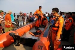FILE - Rescue team members prepare the boat heading to the location of Lion Air, flight JT610, plane crash off the coast of Karawang regency, West Java province Indonesia, Oct. 29, 2018.