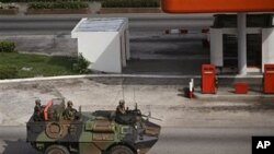 French troops drive past in a armored car in the city of Abidjan, Ivory Coast, March 31, 2011