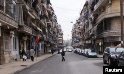 FILE - A man crosses a street in Aleppo, Syria, Dec. 12, 2009.